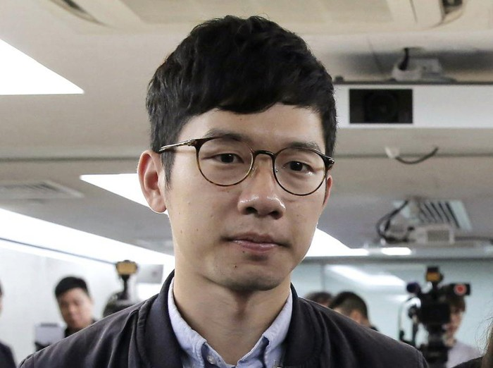 FILE - In this Jan. 27, 2018, file photo, pro-democracy activist Nathan Law, along with Agnes Chow and Joshua Wong, attends a press conference in Hong Kong. Prominent Hong Kong democracy activist Nathan Law has left the city for an undisclosed location, he revealed on his Facebook page shortly after testifying at a U.S. congressional hearing about the tough national security law China had imposed on the semi-autonomous territory. In his post late Thursday, July 2, 2020, he said that he decided to take on the responsibility for advocating for Hong Kong internationally and had since left the city. (AP Photo/Kin Cheung, File)