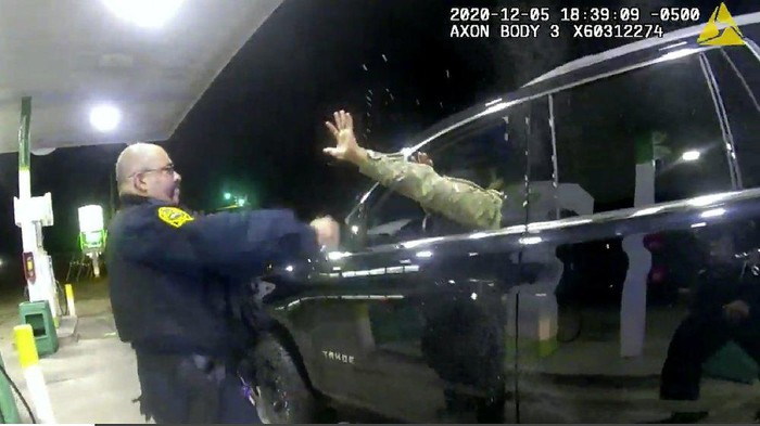 In this image made from Windsor, (Va.) Police video, A police officer uses a spray agent on Caron Nazario on Dec. 20, 2020, in Windsor, Va. Nazario, a second lieutenant in the U.S. Army, is suing two Virginia police officers over a traffic stop during which he says the officers drew their guns and pointed them at him as he was dressed in uniform. Caron Nazario says his constitutional rights were violated by the traffic stop in the town of Windsor in December. (Windsor Police via AP)
