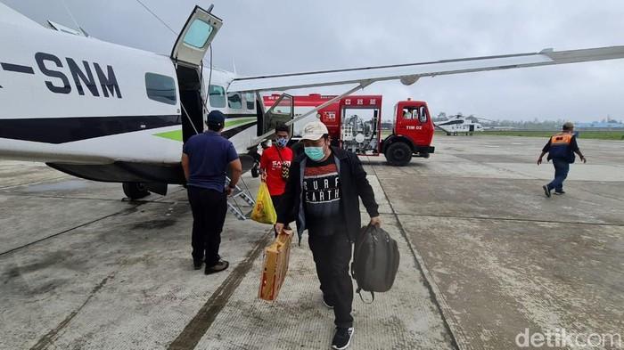 Warga pendatang dari Distrik Beoga, Puncak, Papua tiba di Timka akibat serangan KKB (Saiman/detikcom).