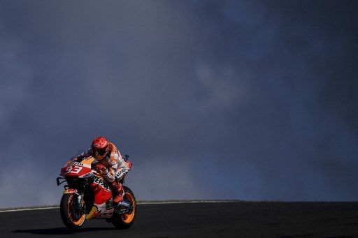 Repsol Honda Team's Spanish rider Marc Marquez rides during the first MotoGP free practice session of the Portuguese Grand Prix at the Algarve International Circuit in Portimao, on April 16, 2021. (Photo by PATRICIA DE MELO MOREIRA / AFP)