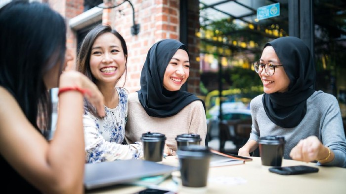 Young Malaysian girls talking to each other and enjoy the gathering.