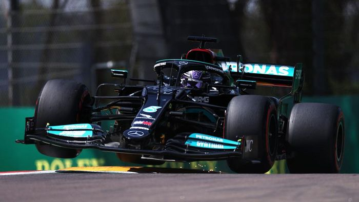 IMOLA, ITALY - APRIL 17: Lewis Hamilton of Great Britain driving the (44) Mercedes AMG Petronas F1 Team Mercedes W12 launches off a raised kerb during qualifying ahead of the F1 Grand Prix of Emilia Romagna at Autodromo Enzo e Dino Ferrari on April 17, 2021 in Imola, Italy. (Photo by Lars Baron/Getty Images)