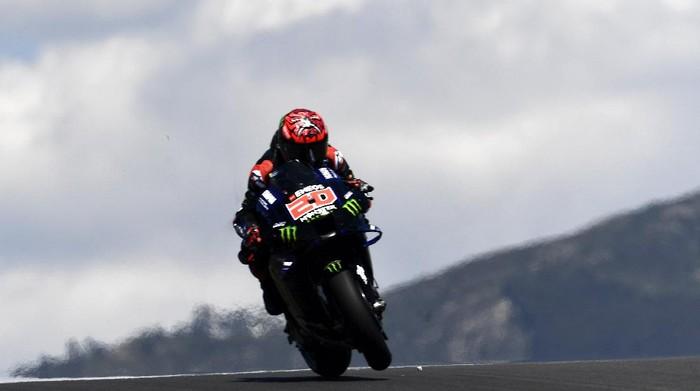 MotoGP rider Fabio Quartararo of France steers his motorcycle during the Portuguese Motorcycle Grand Prix at the Algarve International circuit near Portimao, Portugal, Sunday, April 18, 2021. (AP Photo/Jose Breton)