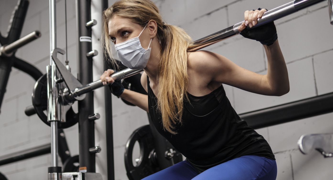 Person working out at gym during pandemic