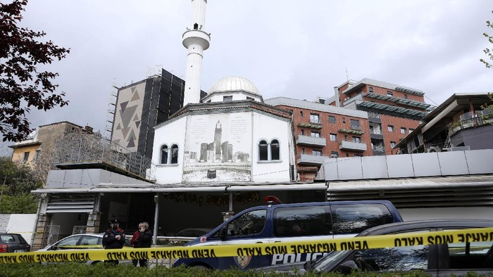 Police stand outside Dine Hoxha mosque after a knife attack in Tirana, Albania, Monday, April 19, 2021. Police say an Albanian man with a knife has attacked five people at a mosque in the capital of Tirana. A police statement said Rudolf Nikolli, 34, entered the Dine Hoxha mosque in downtown Tirana about 2:30 p.m. and wounded five people with a knife. (AP Photo)