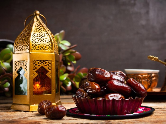 Dates and Arabic style lamp on a table with copy space