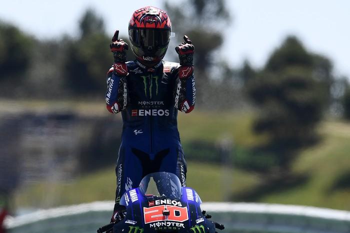 MotoGP rider Fabio Quartararo of France celebrates after winning the Portuguese Motorcycle Grand Prix at the Algarve International circuit near Portimao, Portugal, Sunday, April 18, 2021. (AP Photo/Jose Breton)