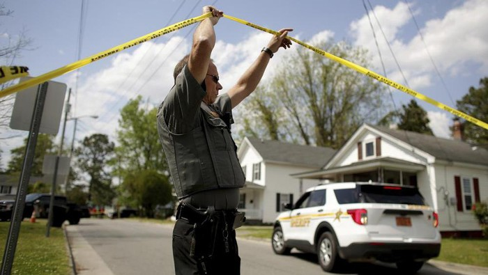 Law enforcement investigate the scene of a shooting, Wednesday, April 21, 2021 in Elizabeth City. (AP Photo)