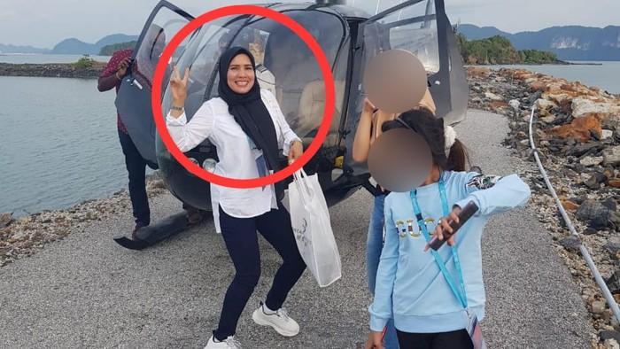 Kanit Reskrim Polsek Tapung AKP Marupa Sibarani dan Panit I Intel Aiptu Amit Elpian saat mendatangi rumah Khairuddin.