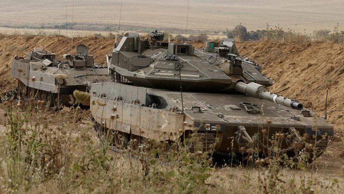 Israeli tanks are stationed along the Israel-Gaza border, on April 24, 2021. - Israeli warplanes struck the Gaza Strip early today after repeated salvos of rocket fire into Israel followed a second night of clashes between Palestinians and police in Israeli-annexed east Jerusalem. Thirty-six rockets were launched, the Israeli army said, the most in a single night this year, after Gazas Islamist rulers Hamas voiced support for the east Jerusalem protests, which were fuelled by a Thursday march by far-right Jews. (Photo by JACK GUEZ / AFP)