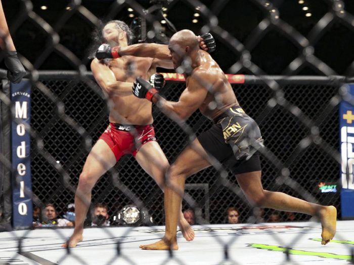Kamaru Usman knocks out Jorge Masvidal during a UFC 261 mixed martial arts bout early Sunday, April 25, 2021, in Jacksonville, Fla.  (AP Photo/Gary McCullough)