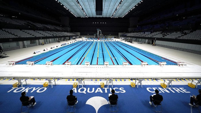 One of swimmers takes off a starting block for a demonstration during Paralympic swimming test event at the Tokyo Aquatics Center, one of the venues of Tokyo 2020 Olympic and Paralympic games, Monday, April 26, 2021, in Tokyo. (AP Photo/Eugene Hoshiko)