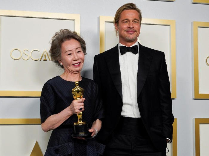 Brad Pitt poses with Yuh-Jung Youn, winner of the award for Best Actress in a Supporting Role for Minari in the press room at the Oscars, in Los Angeles, California, U.S., April 25, 2021. Chris Pizzello/Pool via REUTERS