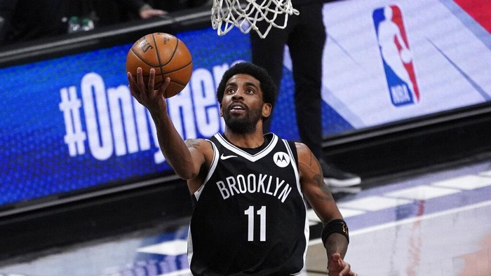 Brooklyn Nets guard Kyrie Irving goes to the basket during the second half of an NBA basketball game against the Boston Celtics, Friday, April 23, 2021, in New York. (AP Photo/Mary Altaffer)
