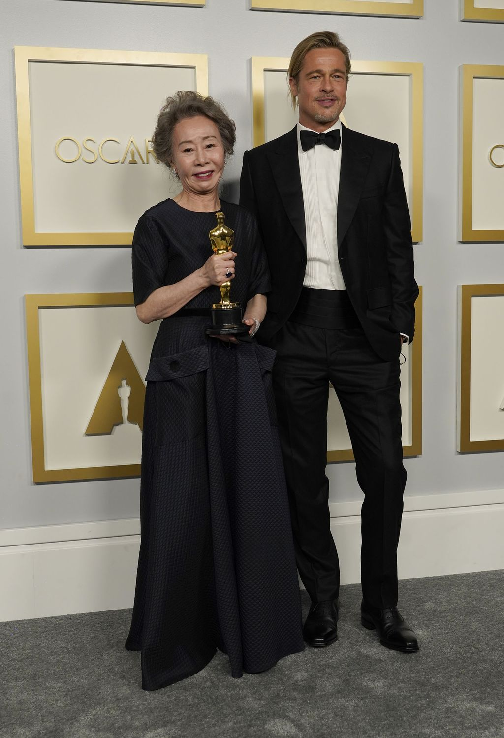 Brad Pitt, right, poses with Yuh-Jung Youn, winner of the award for best actress in a supporting role for