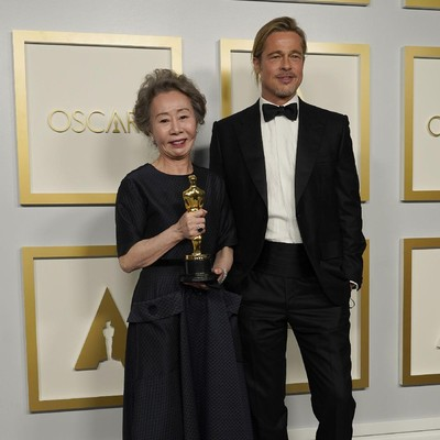 Brad Pitt, right, poses with Yuh-Jung Youn, winner of the award for best actress in a supporting role for Minari, in the press room at the Oscars on Sunday, April 25, 2021, at Union Station in Los Angeles. (AP Photo/Chris Pizzello, Pool)