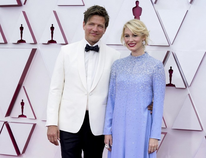 LOS ANGELES, CALIFORNIA  APRIL 25: (L-R) Thomas Vinterberg and Helene Reingaard Neumann attend the 93rd Annual Academy Awards at Union Station on April 25, 2021 in Los Angeles, California.   Chris Pizzello-Pool/Getty Images/AFP (Photo by POOL / GETTY IMAGES NORTH AMERICA / Getty Images via AFP)