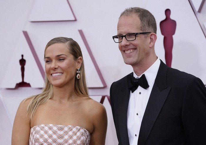 US film producer Dana Leigh Murray (L) and Chief creative officer of Pixar Pete Docter arrive at the Oscars on April 25, 2021, at Union Station in Los Angeles. (Photo by Chris Pizzello / POOL / AFP)