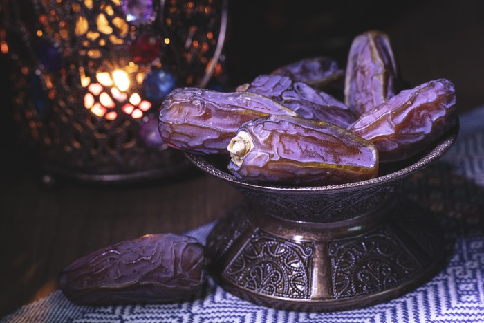 Ramadan concept with dried dates and lantern.