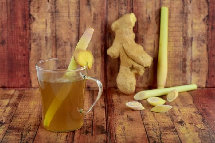 Hot ginger lemongrass tea on wooden background