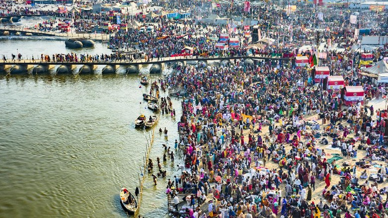 Allahabad, India - February 10, 2013: Allahabad, India - February 10, 2013:Thousands of Hindu devotees come to the confluence of the Ganges and the Yamuna River for holy dip during the festival Kumbh Mela. It is the worlds largest religious gathering