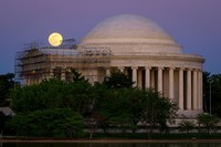 The moon rises over the scaffolding surrounding the entrance to the Jefferson Memorial, in Washington, late Monday, April, 26, 2021. The Jefferson Memorial is in the middle of a multi-year renovation project. (AP Photo/J. David Ake)