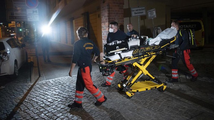 Paramedics leave the Oberlin Clinic hospital in Potsdam, Germany, Wednesday, April 28, 2021. German news agency dpa reported Wednesday that four people have been killed at the hospital in the eastern city of Potsdam and that a 51-year-old woman has been arrested. (Paul Zinken/dpa via AP)