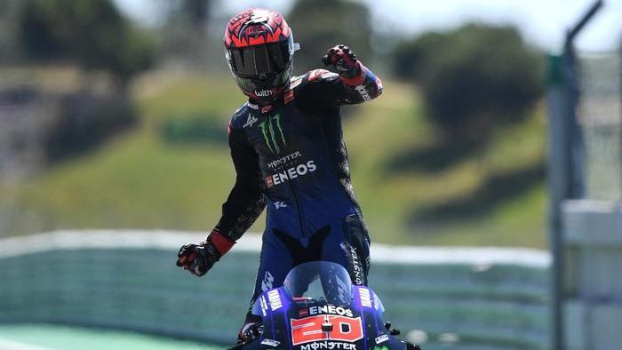 Monster Energy Yamaha MotoGPs French rider Fabio Quartararo celebrates after winning the MotoGP race of the Portuguese Grand Prix at the Algarve International Circuit in Portimao on April 18, 2021. (Photo by PATRICIA DE MELO MOREIRA / AFP)