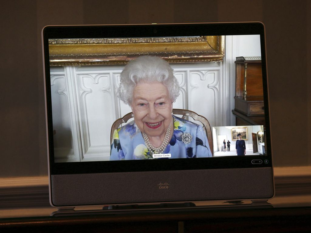 Britain's Queen Elizabeth II appears on a screen by videolink from Windsor Castle, where she is in residence, during a virtual audience to receive Her Excellency Ivita Burmistre, the Ambassador of Latvia, at Buckingham Palace, London, Tuesday April 27, 2021. (Yui Mok/Pool via AP)