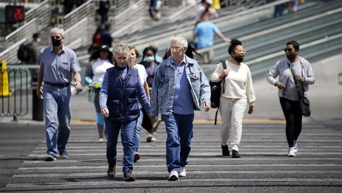 Donna Anderson, left, walks with her friend Christine White, Tuesday, April 27, 2021, in Olympia, Wash. Both women said they are fully vaccinated and have felt comfortable recently in not wearing masks when they are outdoors. On Tuesday, the Centers for Disease Control and Prevention eased its guidelines on the wearing of masks outdoors, saying fully vaccinated Americans dont need to cover their faces anymore unless they are in a big crowd of strangers.