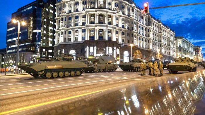 Parked Russian military vehicles preparing to roll along Tverskaya street toward Red Square during a rehearsal for the Victory Day military parade in Moscow, Russia, Thursday, April 29, 2021. The parade will take place at Moscow's Red Square on May 9 to celebrate 76 years of the victory in WWII. (AP Photo/Alexander Zemlianichenko)