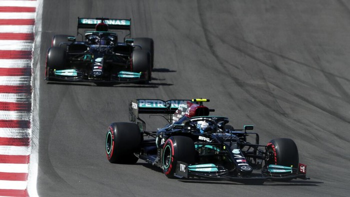 Mercedes driver Valtteri Bottas of Finland takes a curve ahead of Mercedes driver Lewis Hamilton of Britain, left, during the qualifying session ahead of the Portugal Formula One Grand Prix at the Algarve International Circuit near Portimao, Portugal, Saturday, May 1, 2021. The Portugal Grand Prix will be held on Sunday. (AP Photo/Manu Fernandez)