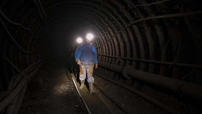 Bosnian coal miners restart their shift after in an underground tunnel at a mine in Zenica, Bosnia, Thursday, April 29, 2021. During Ramadan, observant Muslims abstain from eating, drinking and smoking from dawn until sunset and Zenica coal miners are no exception. (AP Photo/Kemal Softic)