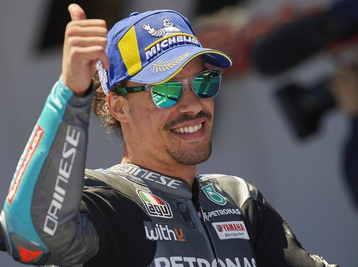 Italian rider Franco Morbidelli celebrates taking third place after the MotoGP Spanish Motorcycle Grand Prix at the Angel Nieto racetrack in Jerez de la Frontera, Spain, Sunday, May 2, 2021. (AP Photo/Jose Breton)