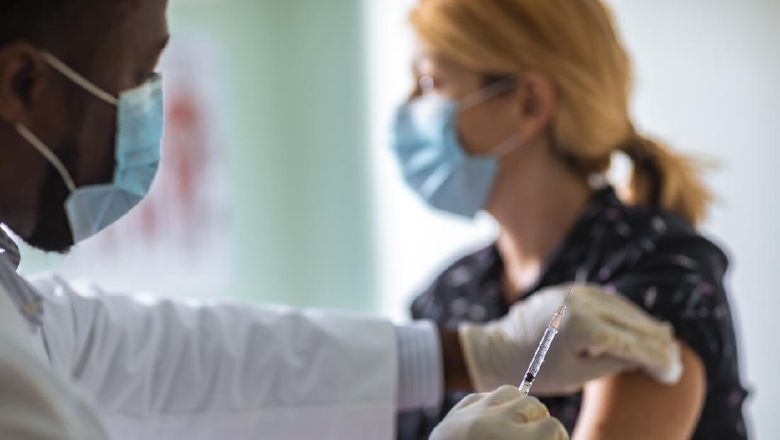 Close up of a young woman getting vaccinated