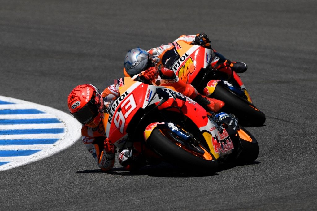 Repsol Honda Team's Spanish rider Marc Marquez (L) and Repsol Honda Team's Spanish rider Pol Espargaro ride during the MotoGP race of the Spanish Grand Prix at the Jerez Circuit in Jerez de la Frontera on May 2, 2021. (Photo by PIERRE-PHILIPPE MARCOU / AFP)
