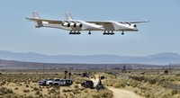 The Stratolaunch aircraft, a six-engine jet with the worlds longest wingspan takes off from Mojave Air and Space Port during crafts second flight, Thursday, April 29, 2021in Mojave, Calif. The gigantic aircraft has flew for the second time in two years.  (AP Photo/Matt Hartman)