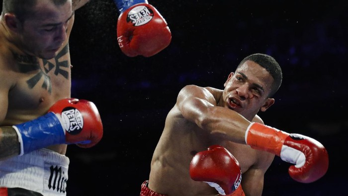 FiLE - In this April 20, 2019 file photo, Puerto Ricos Felix Verdejo, right, punches Costa Ricas Bryan Vazquez during the fifth round of a lightweight boxing match in New York. Verdejo has turned himself in to federal agents on Saturday, May 1, 2021, just hours after authorities identified the body of his 27-year-old lover Keishla Rodríguez in a lagoon in the U.S. territory, a couple of days after she was reported missing. (AP Photo/Frank Franklin II, File)