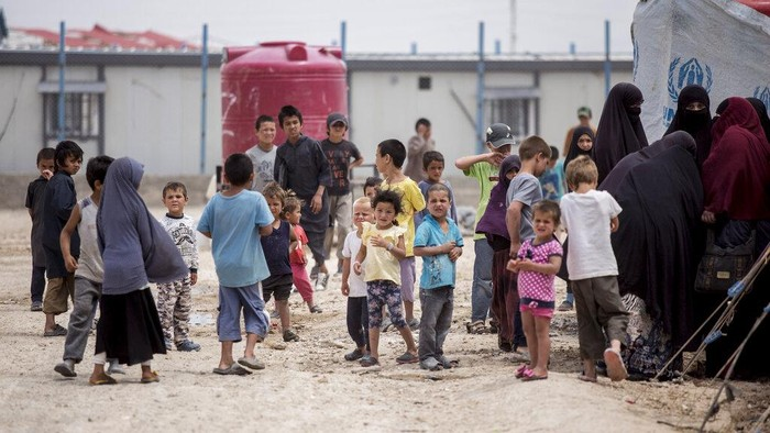 Women and children gather in front their tents at al-Hol camp that houses some 60,000 refugees, including families and supporters of the Islamic State group, many of them foreign nationals, in Hasakeh province, Syria, Saturday, May 1, 2021. Kurdish officials say security has improved at the sprawling camp in northeast Syria, but concerns are growing of a coronavirus outbreak in the facility. (AP Photo/Baderkhan Ahmad)