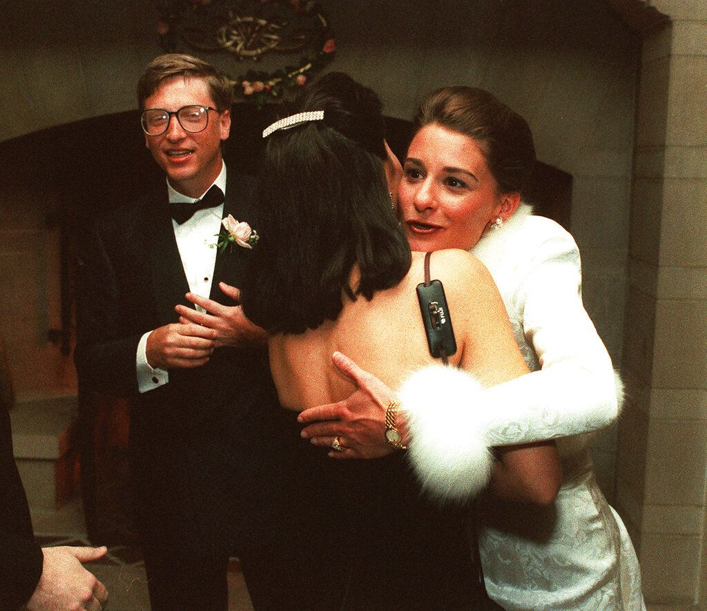 FILE - In this Jan. 9, 1994, file photo, computer mogul Bill Gates III and bride Melinda French greet guests in a reception line at a private estate in Seattle. The couple was married in Hawaii the week prior. Bill and Melinda Gates announced Monday, May 3, 2021, that they are divorcing. The Microsoft co-founder and his wife, with whom he launched the world's largest charitable foundation, said they would continue to work together at The Bill & Melinda Gates Foundation. In identical tweets the Gates said they had made the decision to end their marriage of 27 years. (AP Photo/Dave Weaver, File)