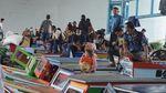 Potret Warga di Sumsel Ramai-ramai Mudik Awal Naik Kapal