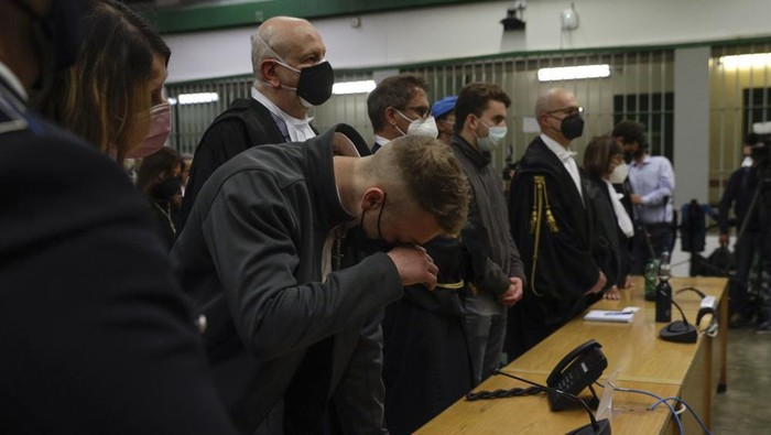 Finnegan Lee Elder listens as the verdict is read, in the trial for the slaying of an Italian plainclothes police officer in summer 2019, in Rome, Wednesday, May 5, 2021. A jury in Rome on Wednesday convicted two American friends in the 2019 slaying of a police officer in a drug sting gone awry, sentencing them to life in prison. The jury deliberated more than 12 hours before delivering the verdicts against Finnegan Lee Elder, 21, and Gabriel Natale Hjorth, 20, handing them Italys stiffest sentence. (AP Photo/Gregorio Borgia)