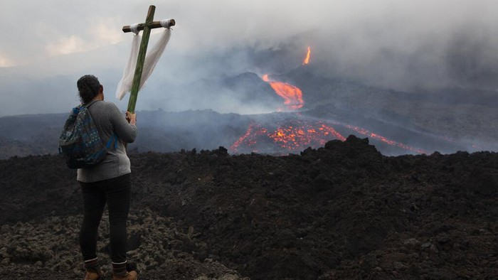 Lava flows down the slopes of Pacaya volcano in San Vicente Pacaya, Guatemala, Wednesday, May 5, 2021. The volcano, just 50 kilometers (31 miles) south of Guatemala's capital, has been active since early February. (AP Photo/Moises Castillo)
