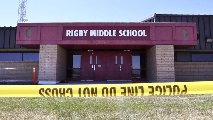Police tape marks a line outside Rigby Middle School following a shooting there earlier Thursday, May 6, 2021, in Rigby, Idaho. Authorities said that two students and a custodian were injured, and a male student has been taken into custody. (AP Photo/Natalie Behring)