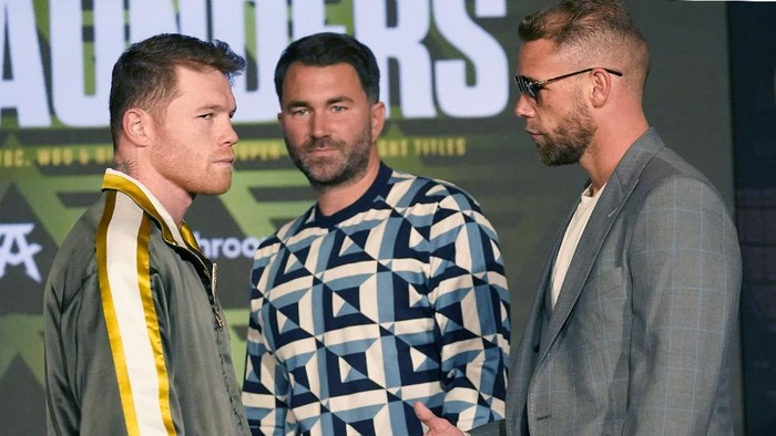 Canelo Alvarez of Mexico, left, turns away as Billy Joe Saunders of Great Britain, right, offers to shake hands as boxing promoter Eddie Hearn looks on during a pre-fight news conference, Thursday, May 6, 2021, in Arlington, Texas. Alvarez and Saunders fight on Saturday, May 8, 2021, for the unified super middleweight world championship. (AP Photo/LM Otero)