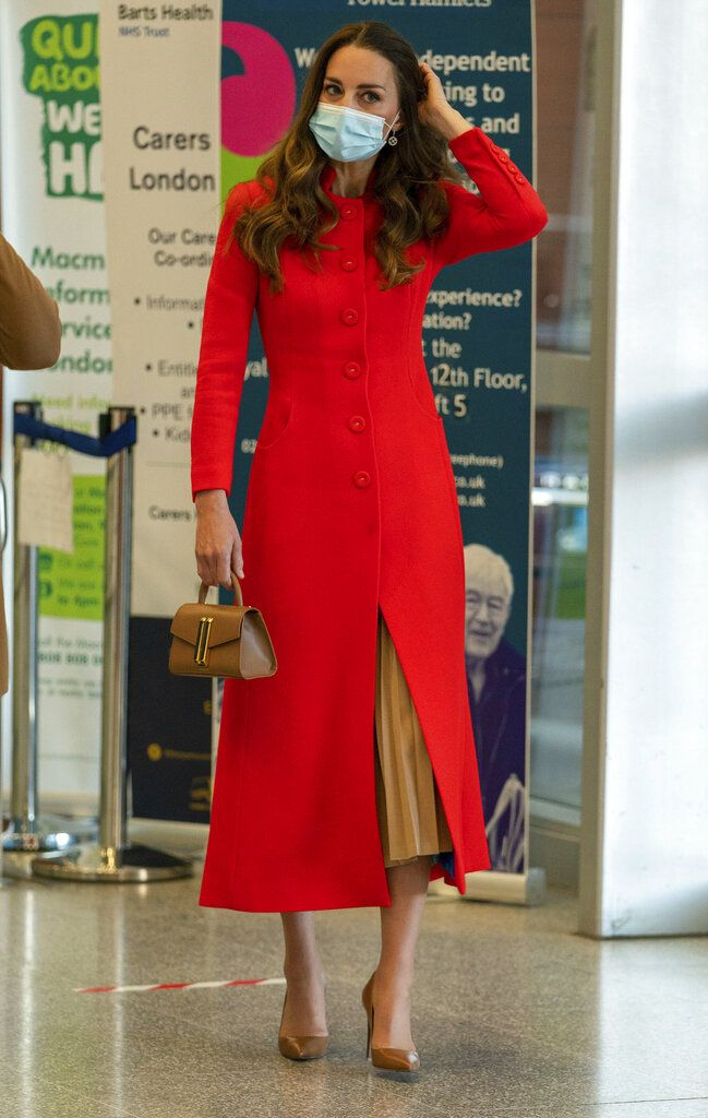 Britain's Kate, Duchess of Cambridge during a visit to the archive in the National Portrait Gallery in central London, Friday, May 7, 2021 to mark the publication of the book 'Hold Still'. (Dominic Lipinski/Pool Photo via AP)