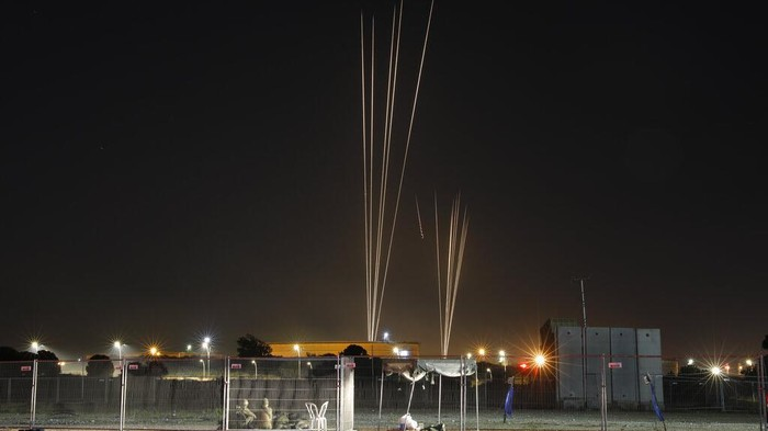 Israeli soldiers duck as rockets are fired from Gaza strip in the south of Israel, Tuesday, May 11, 2021. (AP Photo/Ariel Schalit)