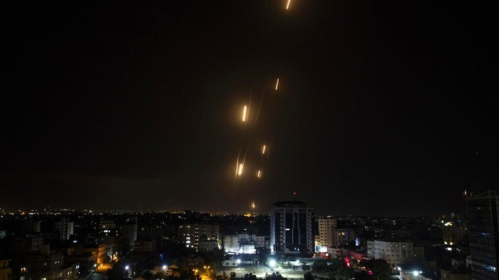 Rockets are launched from the Gaza Strip towards Israel, Tuesday, May. 11, 2021.  The barrage of rockets from the Gaza Strip and airstrikes into the territory continued almost nonstop throughout the day, in what appeared to be some of the most intense fighting between Israel and Hamas since their 2014 war.(AP Photo/Khalil Hamra)