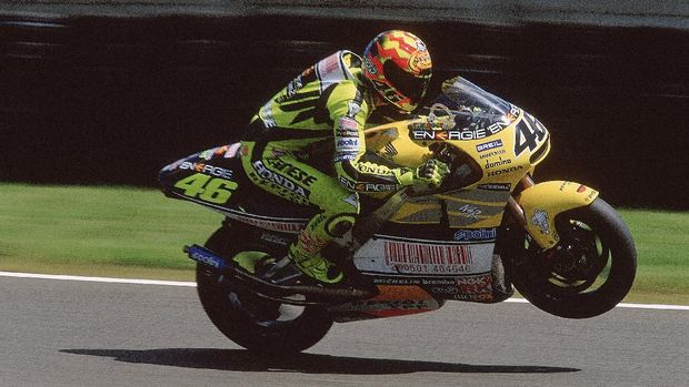 20 May 2001:  Nastro Azzurro Honda rider Valentino Rossi of Italy celebrates with a wheelie after finishing in 3rd place at the 500cc Motorcycle Grand Prix at the Bugatti Circuit in Le Mans, France.  Mandatory Credit: Pascal Rondeau /Allsport