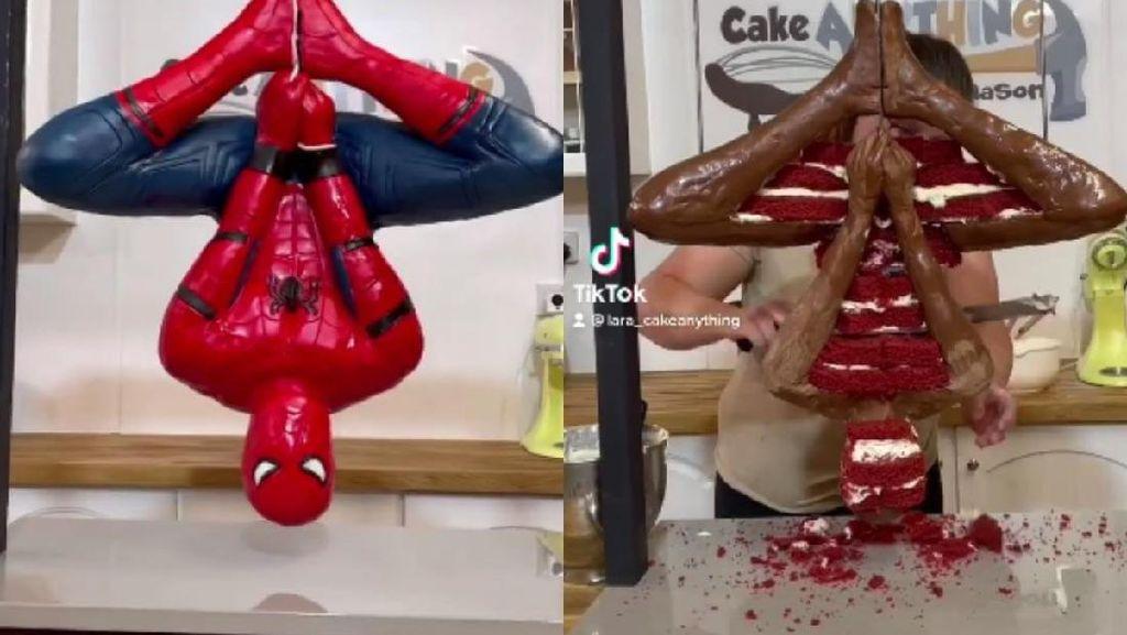 Keren! Wanita Ini Berhasil Bikin Kue Spiderman yang Lagi Gelantungan